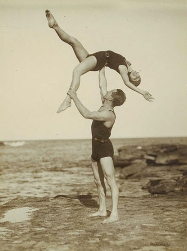 1930's Beach acrobatics (Hendry? Sam Hood.NSWales State Library,Australia/ FLickr/Public domain:expired copyright(ACC)/ Commons.wikimedia.org)