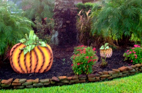 Pumpkin decoration among tropical landscape