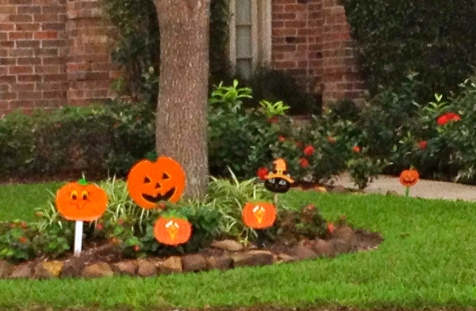 painted pumpkin yard decorations for Halloween