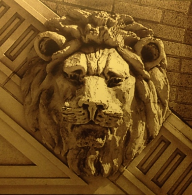 Architectural detail of stone lion facade