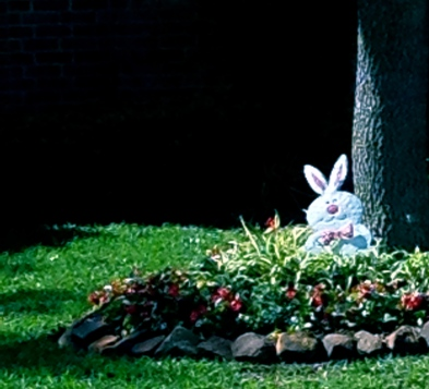 Easter bunny decoration in the flower bed