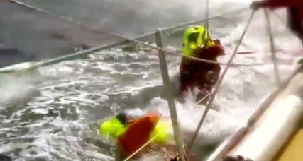 trying to grabMan overboard (Screen shot. Derry-Londonderry-Doire rescue. You Tube)