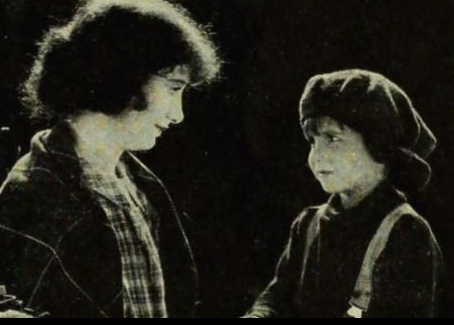 "vintage film.Child with woman.1922""Trouble"".First National films.Coogan/USPD:pub.date/Commons.wikimedia.org"