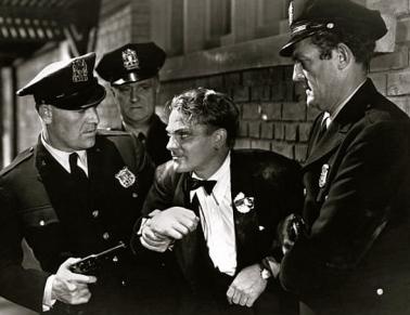 Vintage cops.1931. Public Enemy trailer screenshot: L'Ennemi/US PD:pub.date/artist life/Commons.wikimedia.org)
