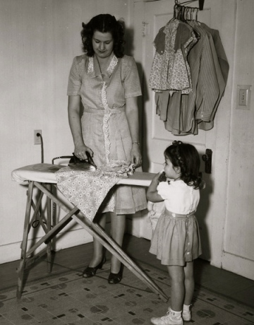 Woman Ironing. 1882-1945. NARA:NLFDR/USPD. by fed employee/Commons.wikimedia.org)