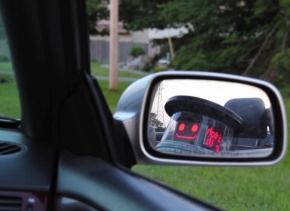 itchBOT in car mirror (hitchBOT.Vimeo)