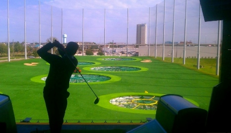 Scott Bateman/Topgolf West/man taking a swing with golf club