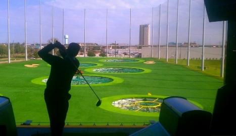Scott Bateman/Topgolf West/man taking a swing with golf club
