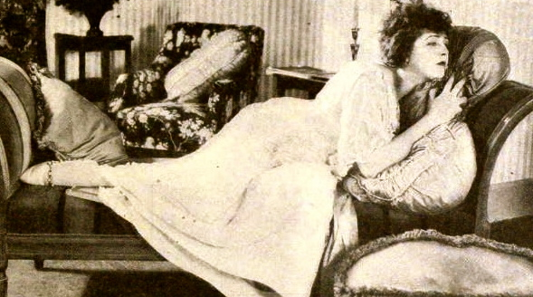 vintage actress reclining on couch. 1921.Katherine MacDonald/Photoplay/ US PD:pub.date/Commons.wikimedia.org