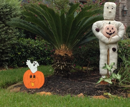 Halloween yard decorations. Mummy, ghost and pumkin