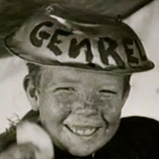 Boy in funny hat. 1923 Mickey Daniels/ Dogs of War film/Hal Roach for Pathe/US PD: pub.date/Commons.wikimedia.org)