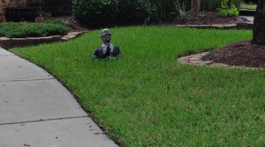 Head and shoulders of ghoul screaming. Halloween yard decoration