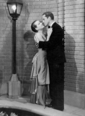 "Elegant couple in movie: 1930.""Spring is Here""/Bernice Claire.Alexander Gray/First National Tiraphone Pictures/USPD: pub.date/Commons.wikimedia.org"
