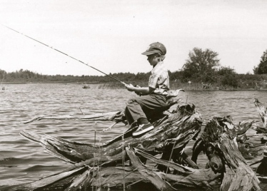 Boy fishing.US Fish and Wildlife Service/US PD: released. by fed employee/Commons.wikimedia.org