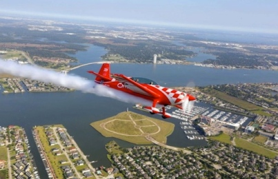 vintage plane, Extra 300L,  flying over the island and Clear Lake / Image by Billy Smith/Hou.Chron.com