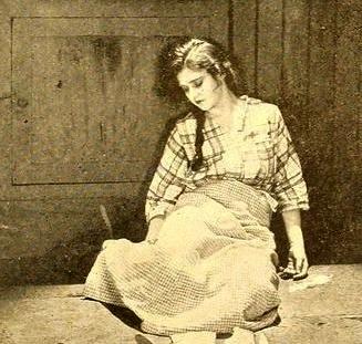 woman slumped on floor. Vintage (1919. Constance Binney. Film.Erstwhile Susan.Motion Picture News, pg 1865.Aug 1919/USPD:pub.date/Commons.wikimedia.org