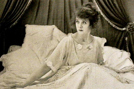 Woman in elegant bed.(1919 Misleading Widow.Billie Burke.Paramount Pictures/US PD:pub.date/Commons.wikimedia.org)