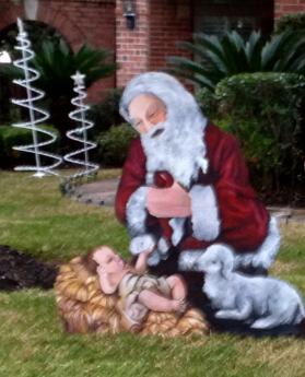 Kneeling Santa with Baby Jesus and lamb. All rights reserved. no permissions granted. Copyrighted