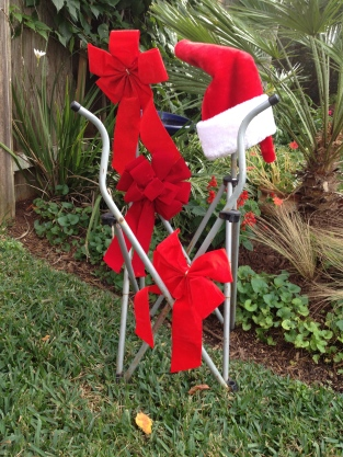 Folding chair with bows and Santa hat. All rights reserved. Copyrighted. No permissions granted