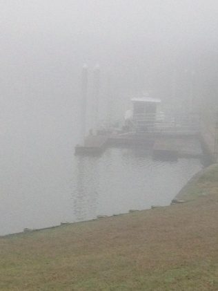 Heavy fog. Boat barely seen at dock. All rights reserved. No permissions granted. Copyrighted