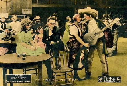 "Vintage film party scene. (1920.""Eastern Westerner"" film lobby card /Rolin Films/Pathe/USPD:Pub.date/Commons.wikimedia.org)"
