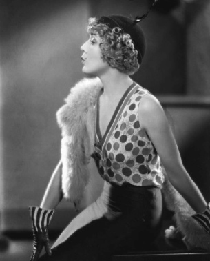Elegant vintage woman seated.1931.Mary Pickford in Kiki by Sam Taylor/USPD:pub.date/Commons.wikimedia.org)