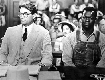 1962. Screenshot.To Kill a Mockingbird characters: Atticus and Tom Robinson (Gregory Peck and Brock Peters)/ USPD.pub.date, no cr/Commons.wikimedia.org