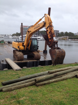Left side(all rights reserved) of backhoe (no permissions granted) on barge. Copyrighted