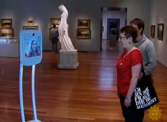 Couple chatting with robot. (screenshot.CBS Sunday Morning Show/YouTube)