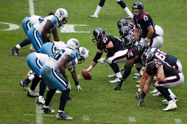 Two football teams face off. Houston Texans vs Tennessee Titans./Jan1,2012/Ed Schipul.Flickr/Commons.wikimedia.org)