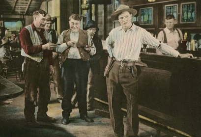 ".Cowboys in a saloon.Movie lobby card. 1921.""Deuce of Spades"".(Unknown illustrator/Beinecke.lib.Yale/USPD. pub.date/Commons.wikimedia.org"