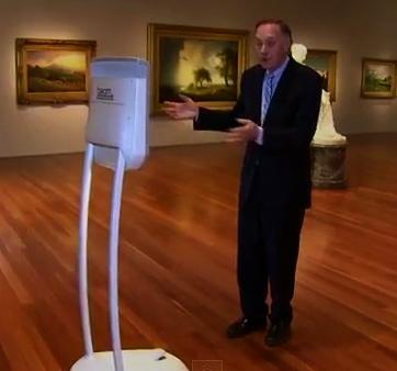 Man gesturing to robot (Screenshot.CBS Sunday Morning Show/YouTube)