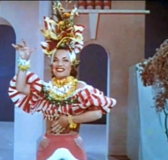 "1941. Carmen Miranda.""Week-End in Havana"" trailer screenshot. 20th Century Fox /USPD:pub.date,no cr/Commons.wikimedia.org)"