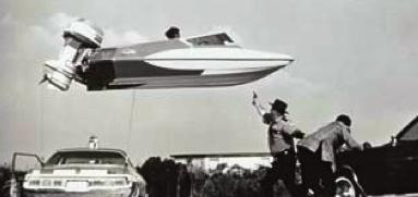 "James Bond. 1973. ""Live and Let Die"". James Bond chase scene.100 foot jump over car.(www.evinrude.com)"