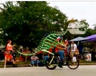 Dino skeleton on bike. (2015 Houston Art Car Parade/Screenshot.YouTube.Carpe Diem Hacks)