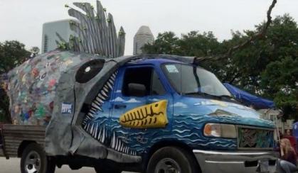 Art Car Giant Fish eating truck.(2015 Houston Art Car Parade. Screenshot. You tube. Carpe diem Hacks