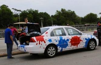 Art Car: white with paint ball splatters of red and blue. (2015 Houston Art Car Parade screenshot/khou.com)