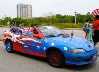 Red white and blue convertible/2015 Houston Art Cat Parade screenshot.khou)