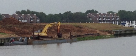 Floating bulkhead barge with backhoe. all rights reserved. NO permissions granted.