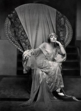 Elegant woman in chair. Actress Norma Talamadge, 1922. Pub.photo/USPD:pub.date/Commons.wikimedia.org)