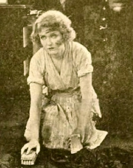 "woman scrubbing floor.1919. May Allison. Film still.""The Uplifters"" Motion Picture News.Metro Pictures Corp./USPD.pub.date/Commons.wikimedia.org"