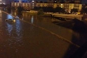 Houston. Car on bridge over flooded bayou. KHOU.com