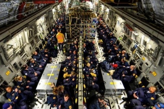 airplane interior. US Mission to Nepal. Fairfax Co URban search and rescue on C-17 Globemaster II (Image:US Mission to NATO/Fairfax fire rescue photo on facebook)