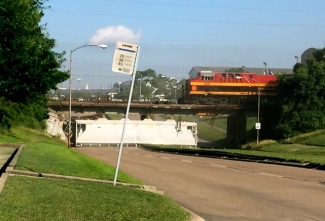 Freight train car on side after falling off elevated train tracks Old KAty Rd:610 Loop. (myfoxhouston.com)