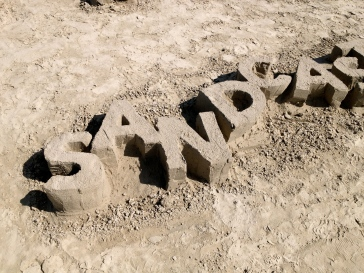 "sharp crisp lettering in sand ""Sandcastles"" All rights reserved. NO permissions granted. Copyrighted."