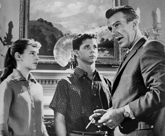 (1960 Screenshot from Leave it to Beaver. Hugh Beaumont.Tony Dow. ABC tv/USPD:pub. date, no cr/Commons.wikimedia.org)