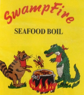 Raccoon and gator around kettle on Swampfire seafood boil package.