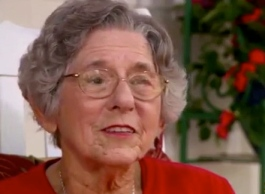 Lou Schell at home talking about her trip. (CBS Sunday Morning Show. screenshot YouTube)