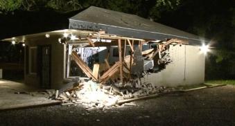 crashed building. Old Towne Spring gun store. (Metro video screenshot chron.com)