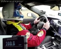 driver insideDriver and  C7 Corvette interior.S Grand Parkway toll road(Hennessey screenshot/Youtube)